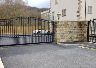 Tracked sliding gates and matching ped gate