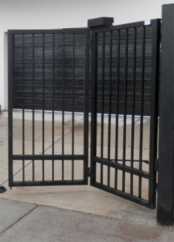 black bi folding electric gates