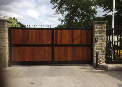 iroko clad cantilever wooden gate