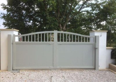 rear single leaf electric gate finished in Accoya