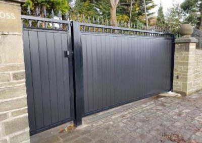 single leaf and pedestrian gate with black composite boards and gsm intercom