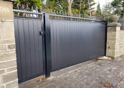 single leaf gate and pedestrian gate with black composite boards and a VIDEX GSM Intercom